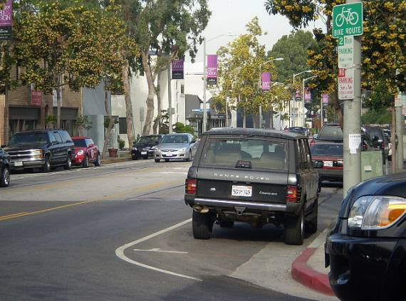 It's time to say it.  Bike route signs are next to useless, and can cause more problems than they solve as this route in West Hollywood shows.