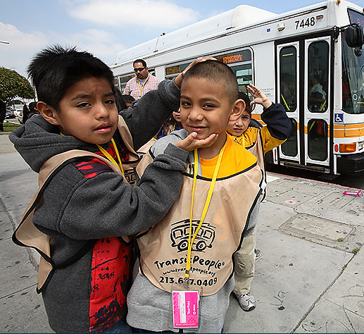 "One child helping another to smile seems like one of the easier challenges teachers could face on a ""free transit field trip.""  Photo: ##http://www.transitpeople.org/photo.shtml##Tim Adams/Transit People##"