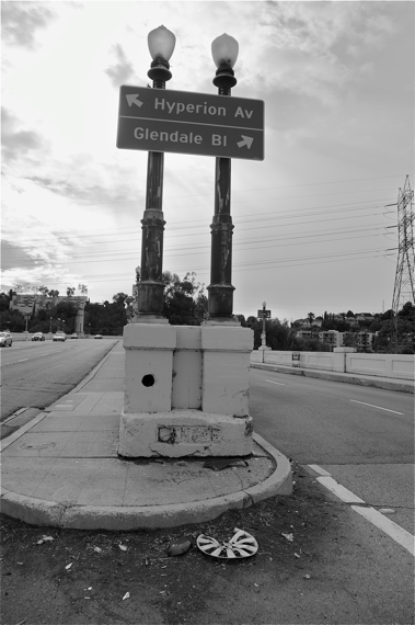 """Heading up the Glendale-Hyperion bridge into Silver Lake. Appropriately, the battered and painted over sign at the base of the lights reads """"DANGER.""""  Sahra Sulaiman/LA Streetsblog"""