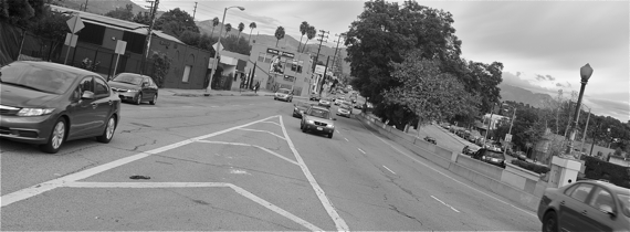Cars fly up Hyperion or towards the 5, flying past me as I stand on the Isle of Pedestrian Despair. Sahra Sulaiman/LA Streetsblog