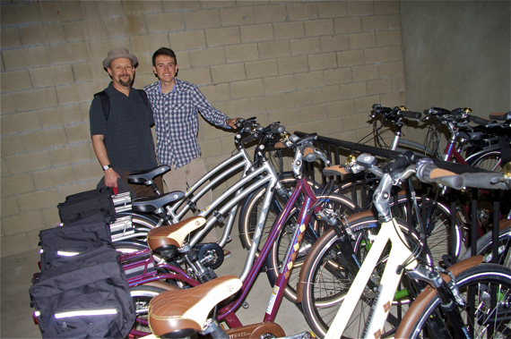 Colin Bogart (LACBC) and Diego Binatena, an Eagle Scout who put together a bikeshare program for two residential facilities for the homeless, stand next to the newly donated bikes at PATH in Hollywood. Sahra Sulaiman/LA Streetsblog
