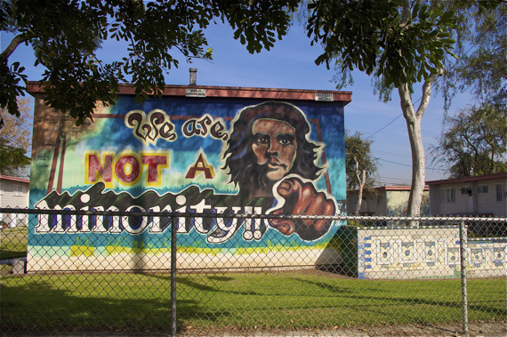 One of the more than 50 murals populating the walls of Estrada Courts in Boyle Heights. Sahra Sulaiman/LA Streetsblog
