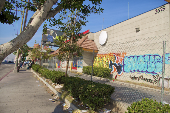 Billboards, graffiti, and trash mar the landscape along sections of Olympic. Sahra Sulaiman/LA Streetsblog