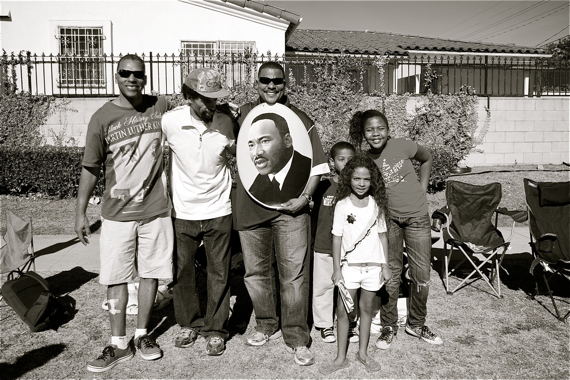 Families along Martin Luther King Blvd. celebrate at the King Day parade last year. Sahra Sulaiman/LA Streetsblog