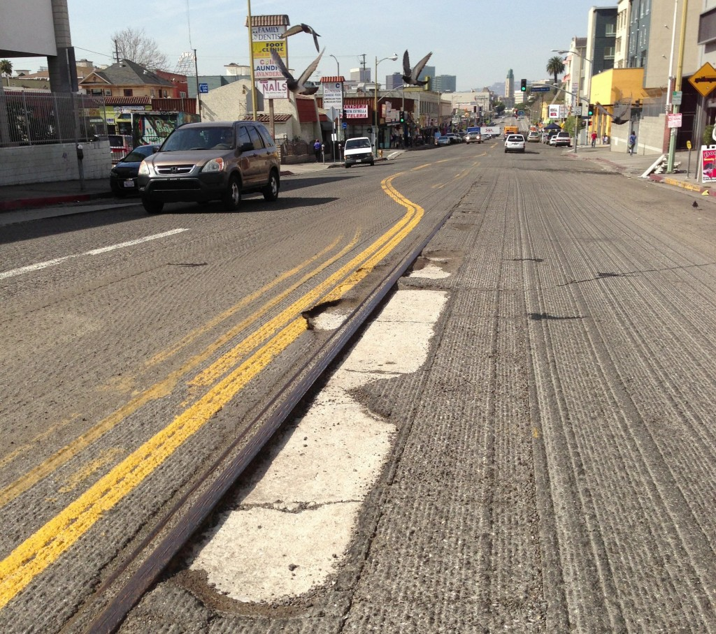 Eyes on the street: resurfacing scrape reveals old streetcar railroad track under 7th Street at Burlington  Avenue, just east of MacArthur Park