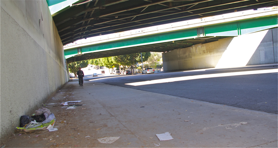 Trash accumulates under an underpass along Whittier Blvd. Sahra Sulaiman/Streetsblog L.A.