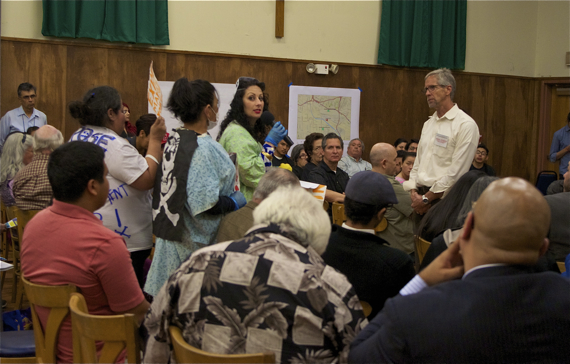 """I'm a teacher, I'm pregnant...I'm worried,"" a woman tells DTSC officials at a meeting regarding Exide's lead emissions. Sahra Sulaiman/LA Streetsblog"