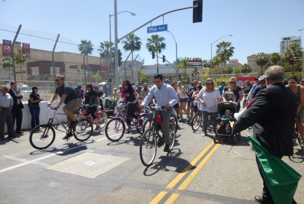 Long Beach may not have a ciclovia style open street event, but Vice-Mayor Robert Garcia is front and center when the Long Beach Grand Prix allows cyclists to use its closed course the day before the race. Image: ##http://lbpost.com/news/2000003501-the-return-of-the-grand-prix-ciclovia-of-long-beach#.U2Qmr61dUs0##Long Beach Post##