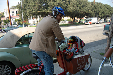 When Damien and Sammy went on their first bike ride in January 2010, we knew of one other baby that was riding in a cargo bike in Greater L.A. While it's hardly mainstream, there are dozens of families using cargo bikes for kid-transportation today.