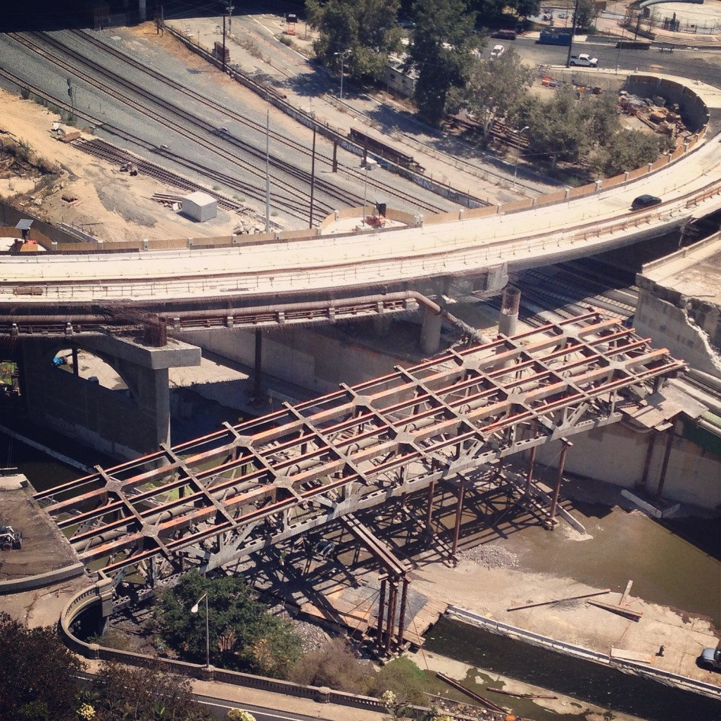Steel truss frame fully revealed during the demolition of the Riverside-Figueroa Bridge. Photo: Daveed Kapoor