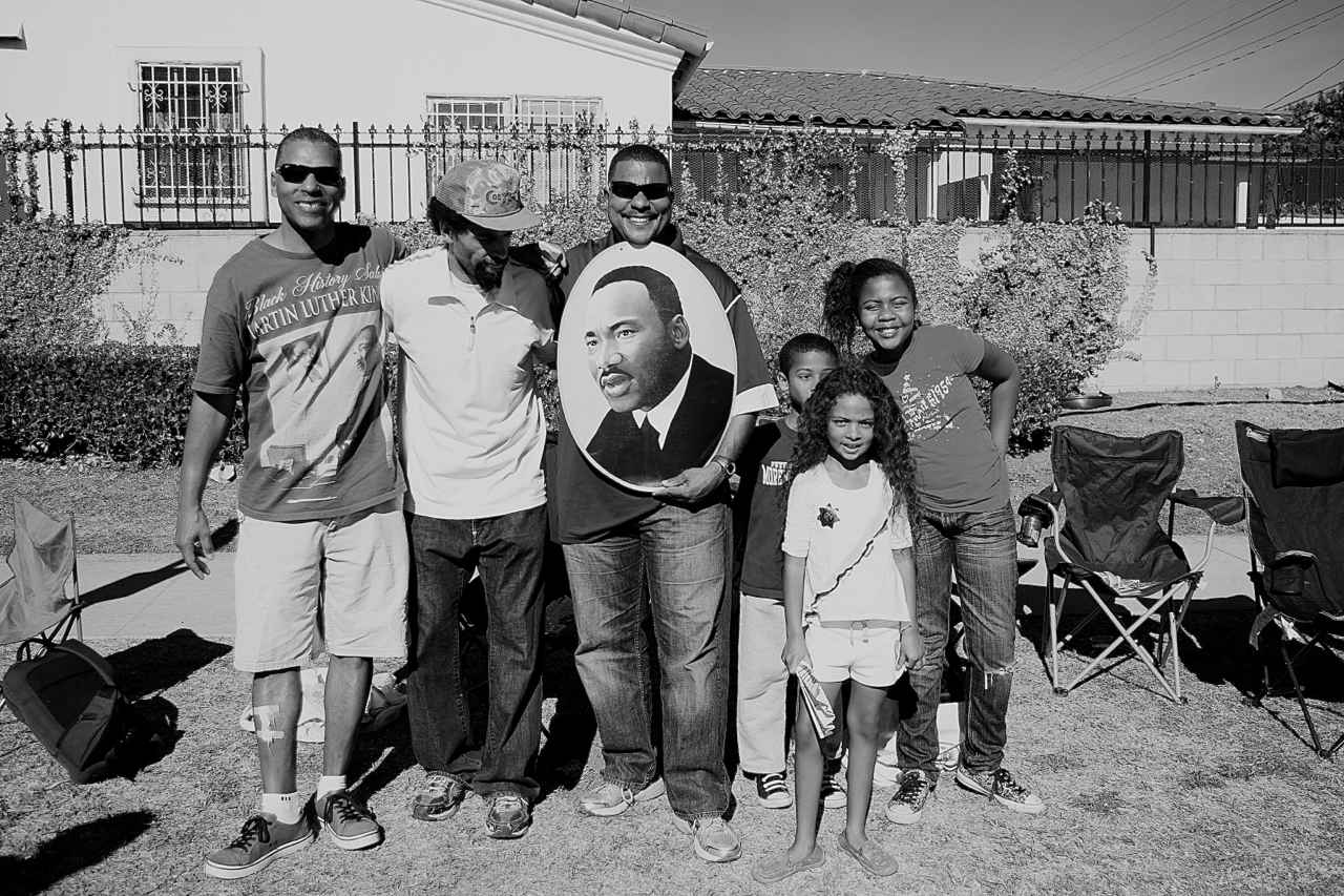 Families along Martin Luther King Blvd. celebrate at the King Day parade last year. Sahra Sulaiman/Streetsblog L.A.