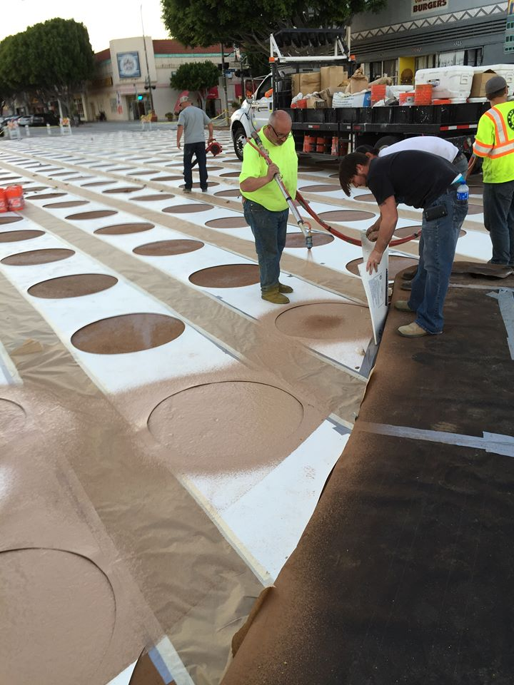 LADOT crews painting the new plaza at Leimert Park last week. Photo by Kathleen Smith