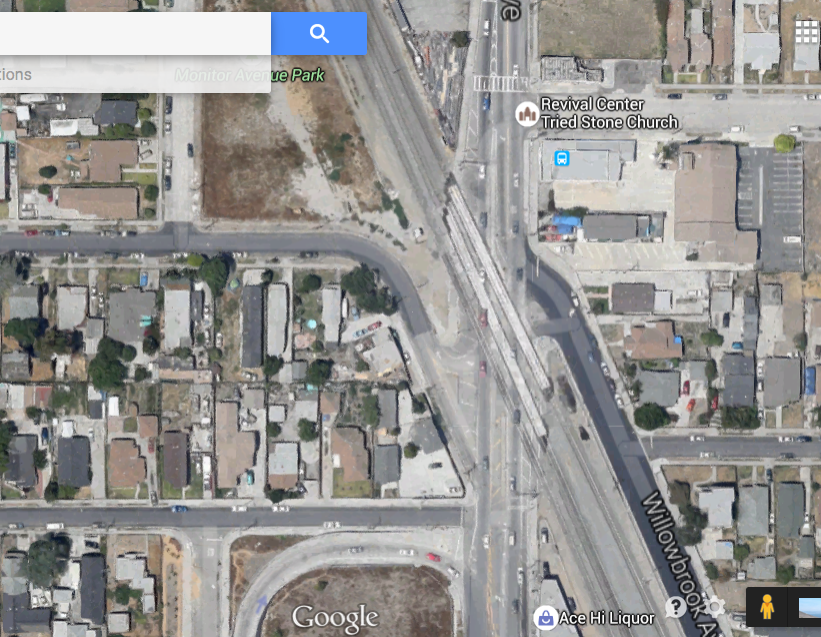 The intersection of Wilmington and Willowbrook, bisected diagonally by several sets of train tracks is a very unfriendly place for pedestrians and cyclists. (Google map screen shot)