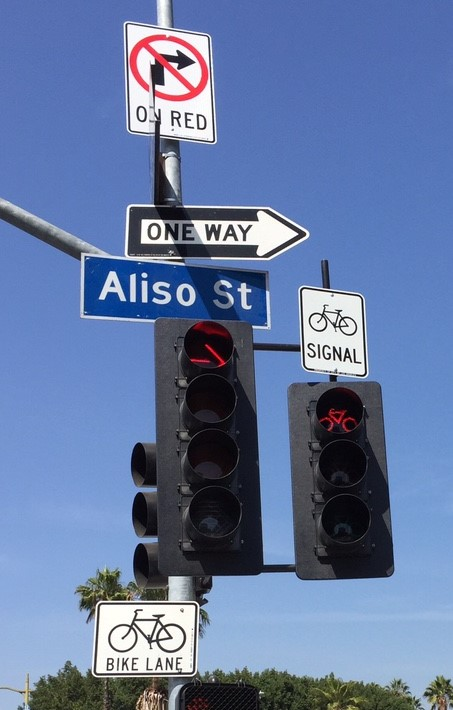 Bicycle traffic signal to allow cyclists a separate phase from turning cars