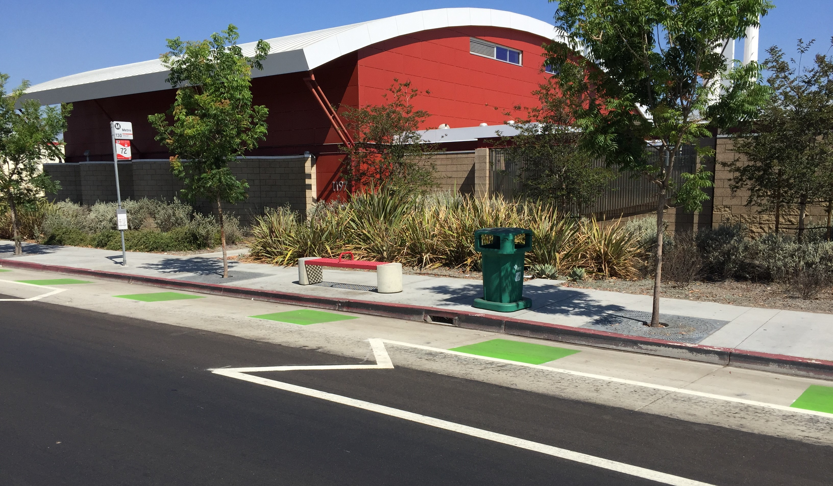 Example of unprotected merge zone at bus stops on Artesia Blvd protected bike lanes