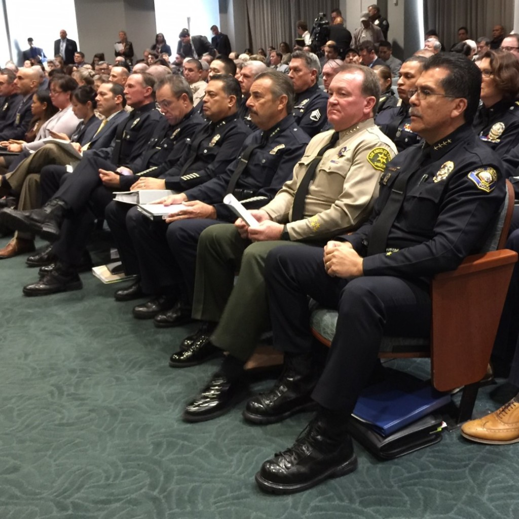 Seated in the front row are LAPD Chief Charlie Beck, LA County Sheriff Jim xxx